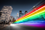 Fototapety Colorful rainbow bus traffic blur in city