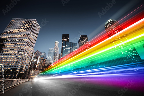 Fotobehang Los Angeles Colorful rainbow bus traffic blur in city
