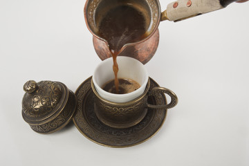 Cup of Turkish coffee on white