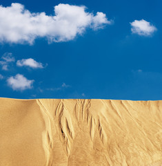 Sand desert landscape with clouds