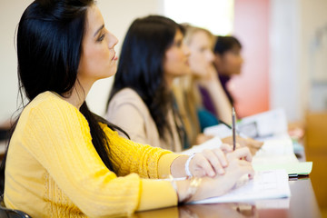 group of young college students in classroom