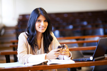 beautiful college student in lecture hall with mobile phone