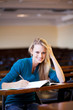 young female college student studying in classroom