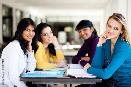 group of female college students sitting by school cafeteria