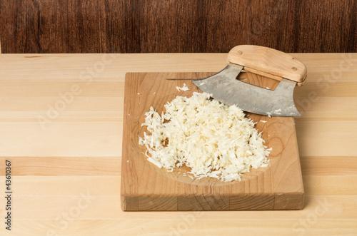 Fresh horseradish being grated