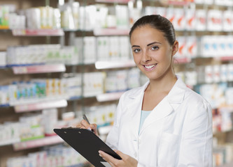 Portrait of Smiling Woman Pharmacist whit clipboard