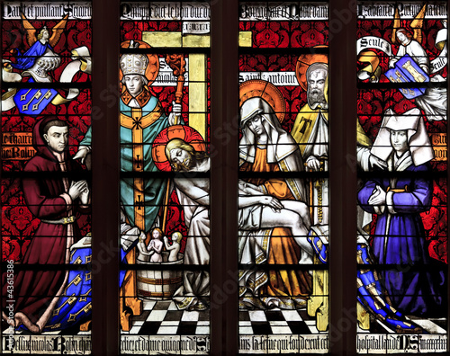 The stained glass window of Piety at hospice in Beaune