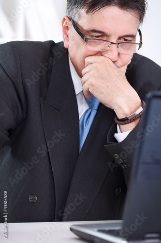 Upset senior businessman  working