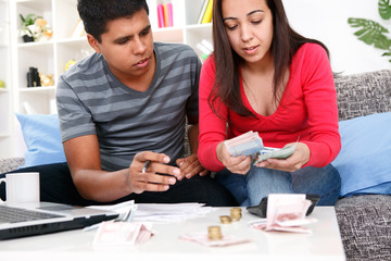 Young  couple looking at their home expenses