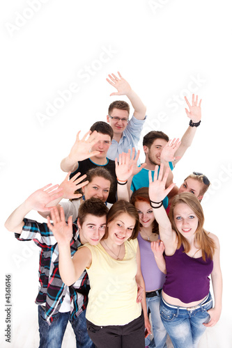 Group of smiling friends waving their arms
