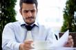 Handsome men with paperwork