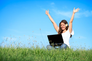 Happiness woman working with laptop, outdoor
