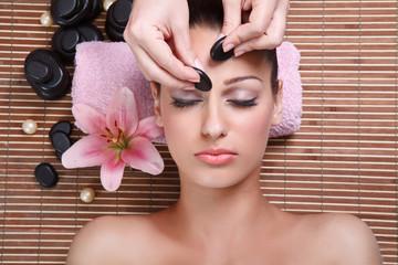 young beautiful woman having facial massage