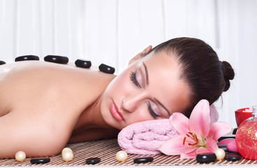 relaxed woman receiving spa treatment