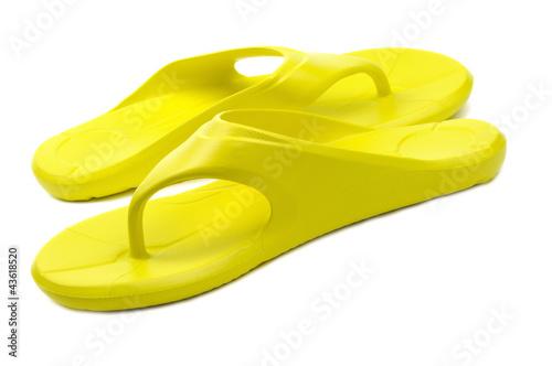 Yellow flip flops, white background