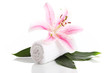 Towel and pink lily flower