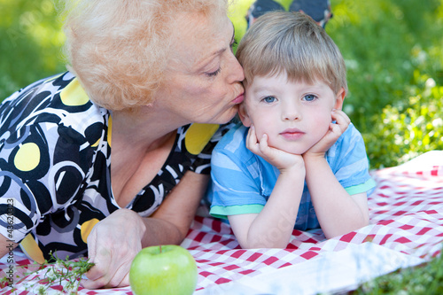 Grandmother kissing her grandson