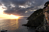 Sunset over the 13th century village of Riomaggiore.