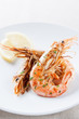 Plate of grilled shrimp with lemon and parsley
