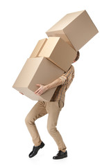 Man hardly carries the cardboard boxes, isolated