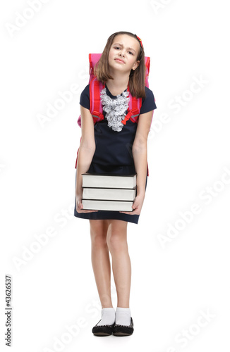 Schoolgirl with the briefcase and the pile of heavy books