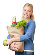 Attractive woman with a paper bag full of healthy eating