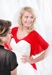 Bride puts the wedding gown