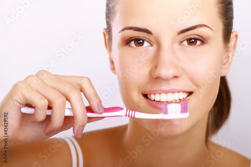 Woman with great teeth holding tooth-brush