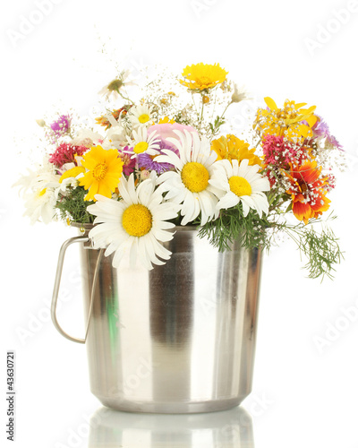 beautiful bouquet of bright  wildflowers in metal bucket,