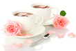 cups of tea with roses isolated on white