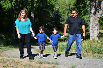 Family walking on a country road