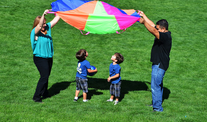 Family Playing with Parachute in a Park