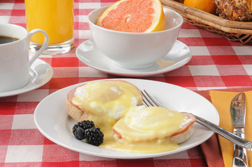 Eggs benedict with pink grapefruit