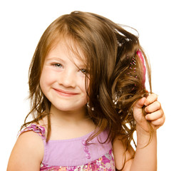 Hair care concept with portrait of girl brushing hair