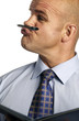 Man holding a pen in between his nose and lips