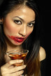 Woman with smudged lipstick holding a glass of champagne