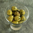Glass of fresh Italian olives