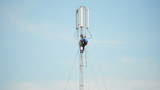 Engineers-fitters install antenna for mobile communication poster