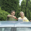 Man and woman washing car together