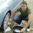 Man washing car wheel
