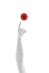 Brazo señalando bola roja