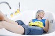 Woman sleeping in the bathtub