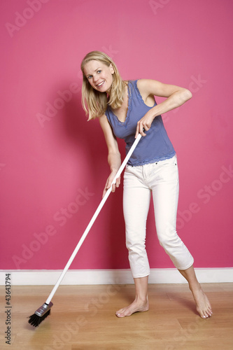 Woman sweeping the floor