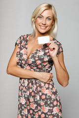 Elegant smiling female showing an empty credit card
