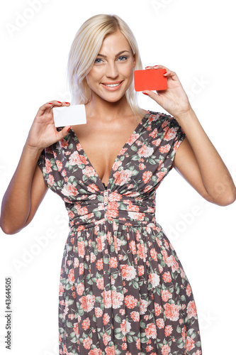 Young smiling business woman holding two credit cards