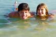 Teenage couple in water