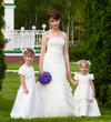 Bride costs with little girls in elegant dresses