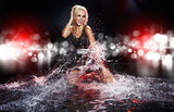 Saxy woman dancing in water on black ,