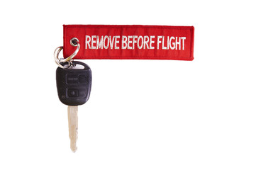 Car keys with Tag Remove Before Flight Red on White Background