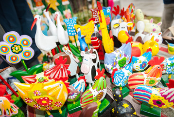 Traditional colorful wooden toy animals in the bazaar